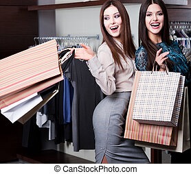 Amazing discounts - Two friends are in the shopping center...
