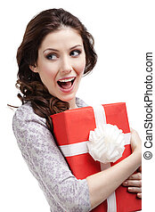 Young woman hands a new year's gift