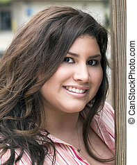 Portrati Plus-Size Hispanic Woman Outdoors Smiling - Outdoor...