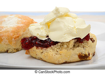 Scone with raspberry jam and cream - Traditional scone with...