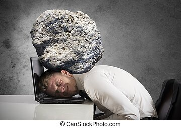 Stress - Concept of stress with businessman with a rock on...
