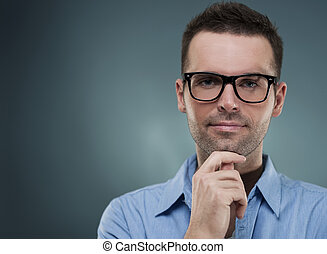 Attractive man in glasses and hand on chin