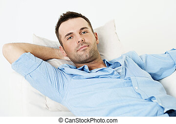 Handsome man relaxing with hand behind head
