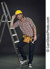 Manual worker leaning on the ladder