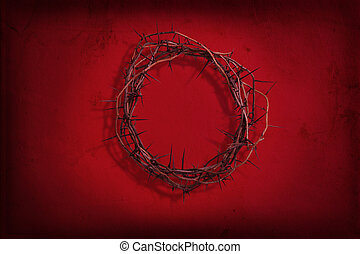 Crown of thorns on red grunge background - A crown of thorns...