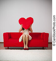 Elegant and fashion woman holding heart shape pillow