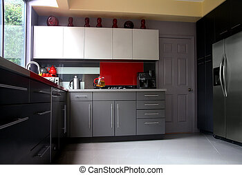 Modern kitchen - A modern kitchen with gray cabinets and...