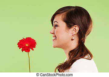 Pretty woman holding red flower