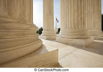 American flag viewed between columns of Supreme Court...