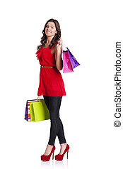 Young woman holding shopping bag