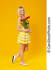 Blonde woman holding bouquet of spring flower