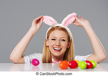 Laughing easter bunny woman