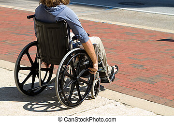 Injured Wheelchair Man - Injured male veteran sitting in his...
