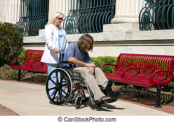 Nurse Disabled Patient - Nurse caregiver looks after a...