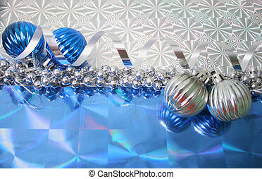 Christmas Decorations - A lovely blue baubles on a hologram...