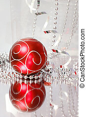 Christmas Decorations - A lovely red baubles on a mirror...