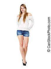 Young smiling blond woman posing in blue jeans shorts and...