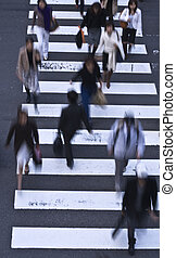 People crossing the street - Group of people crossing the...