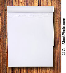 white blank paper tablet on wood