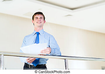 Portrait of a businessman standing in the office, keep the...