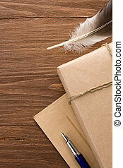parcel and pen on wood background