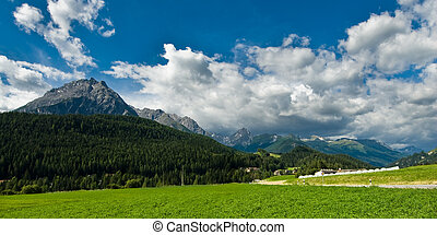 Mountains at Scuol - Scenic view of a mountain range around...