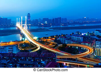 Bridge Night - Night view of the bridge and city in shanghai...
