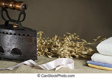 Retro Iron On the Canvas Against Beige Background