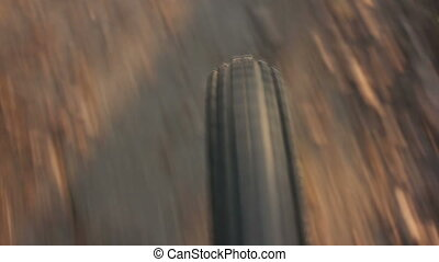 Riding quickly - Bicycle wheel close-up HD