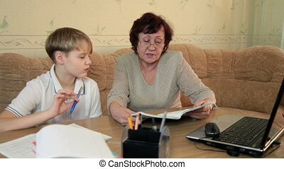 Grandma helping grandchild - Grandmother helping grandson...