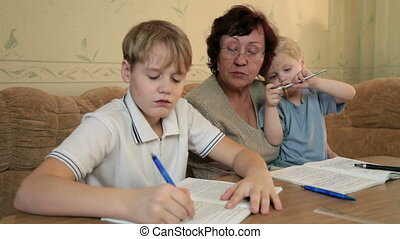 Grandma with grandsons at home - Grandmother spends time...