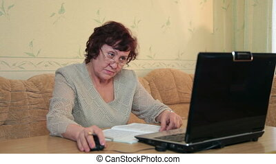 Senior woman using laptop - Senior woman working on laptop...