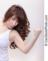 Attractive woman making a fist - Attractive woman with long...