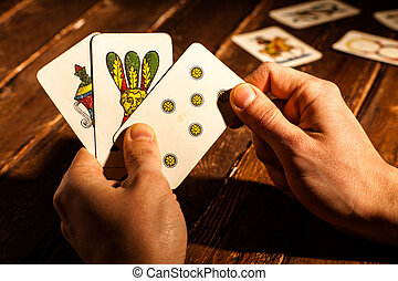 Neapolitan Card - Hands Playing with Neapolitan Cards