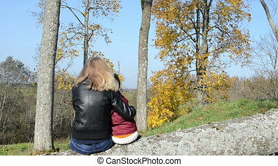 mother daughter admire - blond woman mother sit on broken...