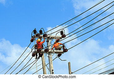 An electrical power utility worker fixes the power line.