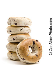 Stack of Bagels - One blueberry bagel resting on a stack of...