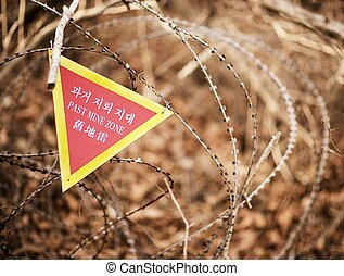Past Mine Zone - A sign indicating the end of a landmine...