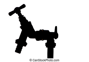 silhouette of an outside water tap fitted to standpipe