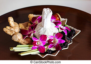 Thai spa arrangement for massage Herbal bag, orchids, decor...