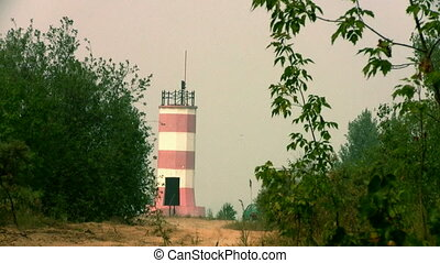The old lighthouse on a foggy day