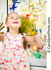 Portrait of a cute girl playing with paints - Portrait of a...
