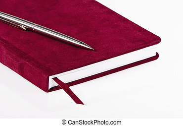 Red journal and pen - Red journal and a pen over white...