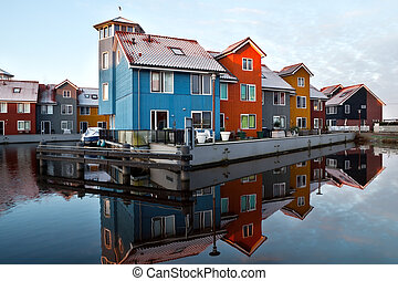 Dutch colorful buildings on water at sunrise, Netherlands
