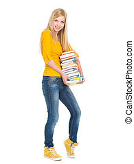 Full length portrait of happy student girl holding stack of...