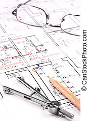 Architect plan - Eyeglasses and drawing compassl on...
