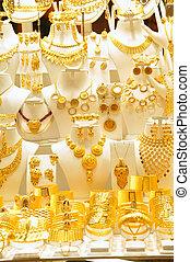Gold jewelry in grand bazaar - Bracelets on a show window...
