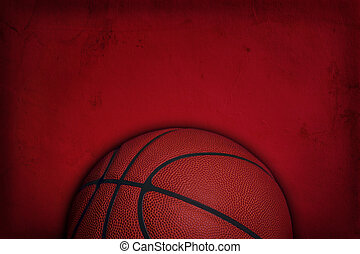 Basketball on red grunge textured background - Top half of a...