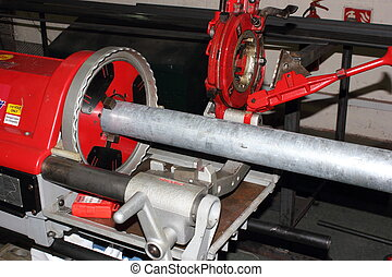 Thread and pipe cutting machine used by pipe fitters