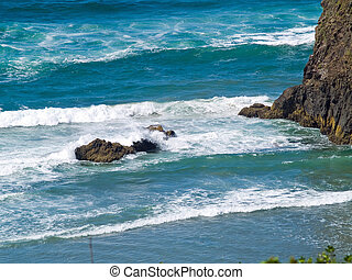 Boulder on the Shore with Waves Crashing